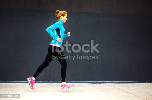 istock Healthy lifestyle fitness sports woman running 472558236