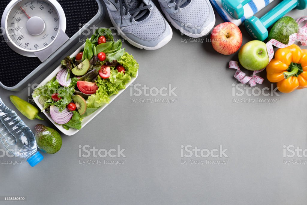 Healthy lifestyle, food and sport concept. Top view of athlete\'s...