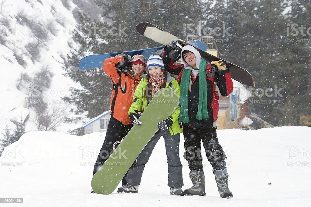 Healthy lifestyle image of happy snowboarders team, Snowfall stock photo