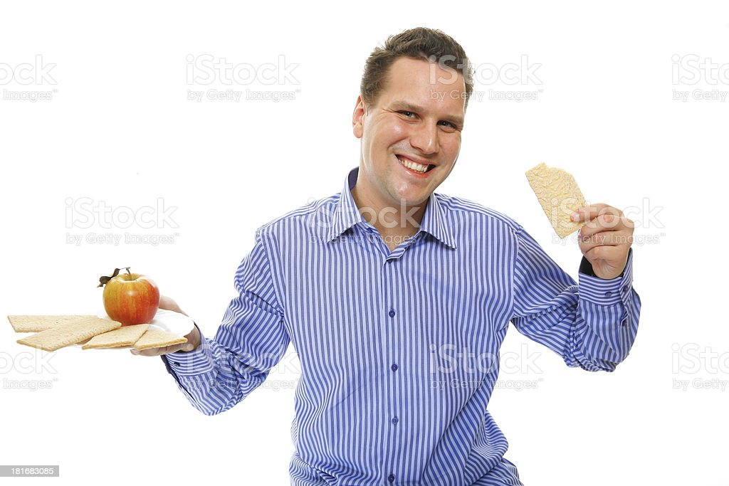 Healthy lifestyle man eating crispbread and apple royalty-free stock photo