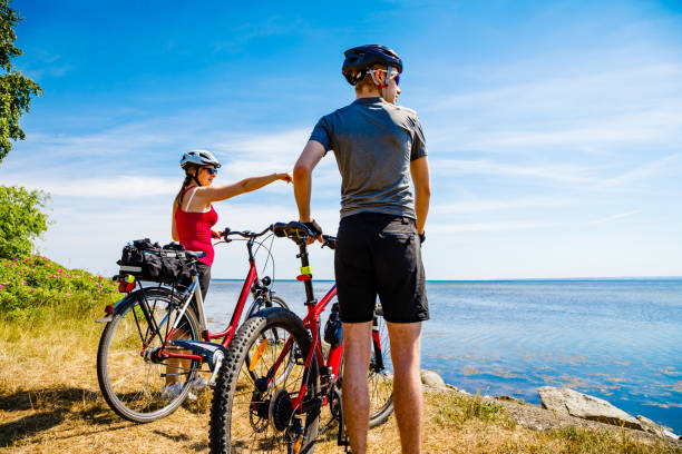 Healthy lifestyle - people riding bicycles at seaside Healthy lifestyle - people riding bicycles female biker resting stock pictures, royalty-free photos & images