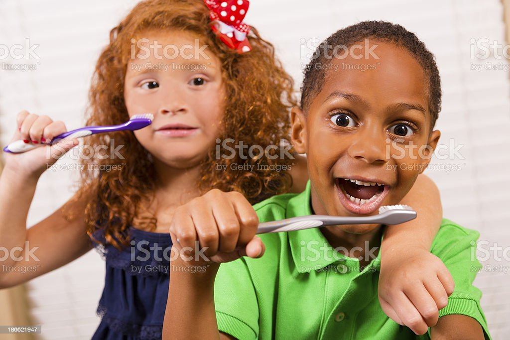 Healthy Lifestyle:  Two elementary age children brushing teeth. royalty-free stock photo
