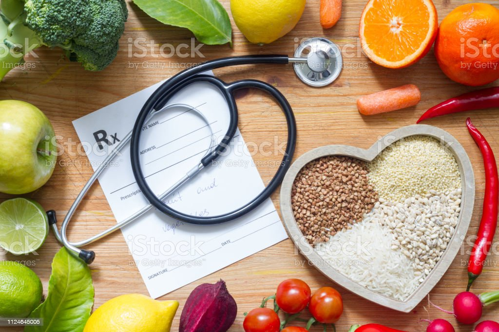 Healthy lifestyle  with vegetarian food in heart and  stethoscope  alternative medicine concept stock photo