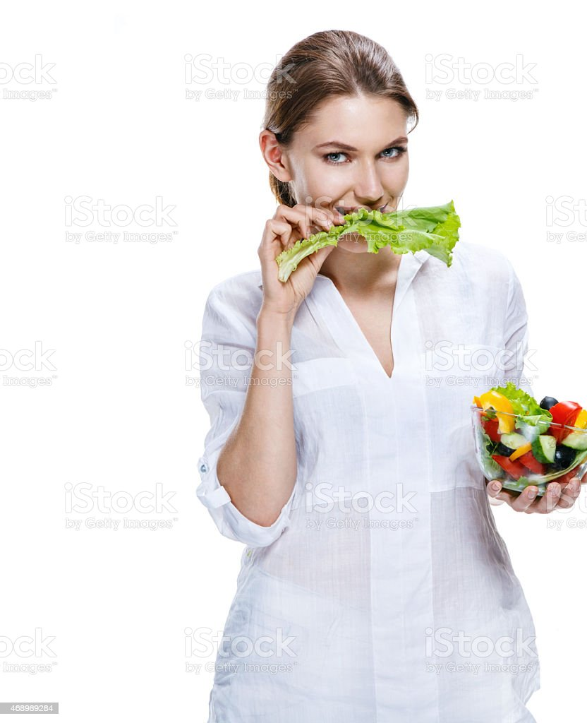Healthy lifestyle woman eating salad smiling happy, healthy food concept stock photo