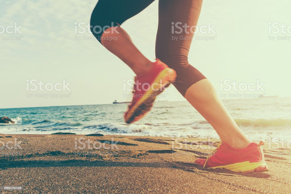 healthy lifestyle young woman runner running on sunrise stock photo