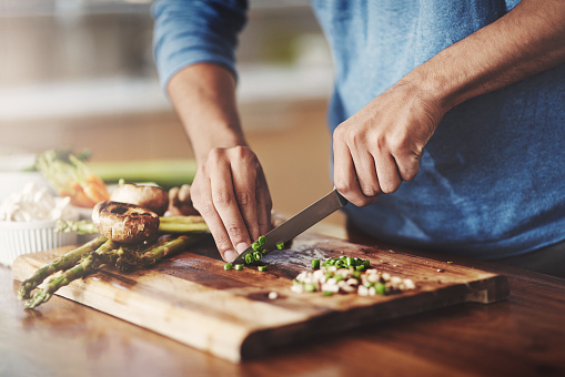 Cropped shot of a man preparing a healthy meal at home