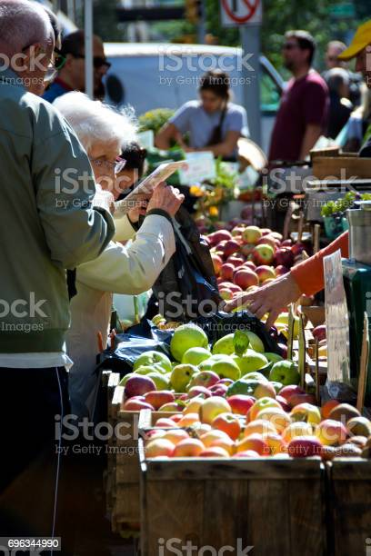 Healthy living seniors buying fresh apples at farmers market upper picture id696344990?b=1&k=6&m=696344990&s=612x612&h=le9yxtsv90xvckgq3cndt5i054rooykw1ahv9lkho7u=