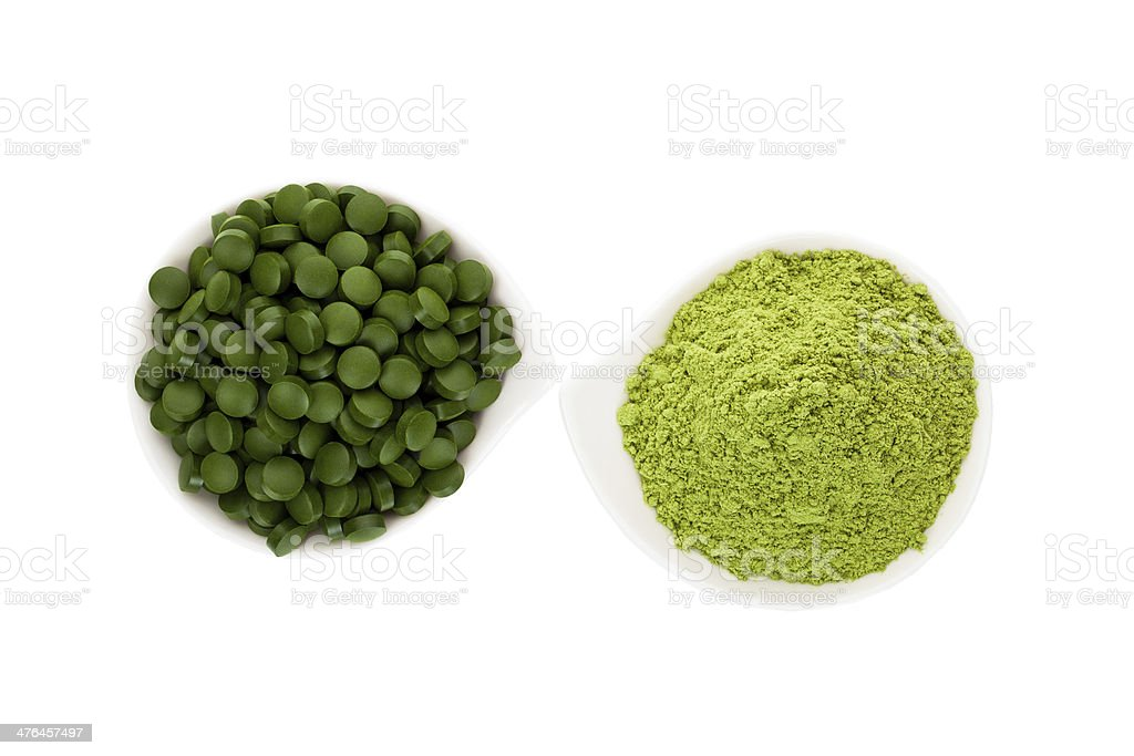 Healthy living. Spirulina pills and wheatgrass. royalty-free stock photo