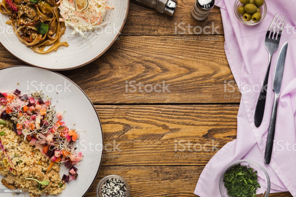 Healthy lunch at restaurant on wooden table, top view royalty-free stock photo