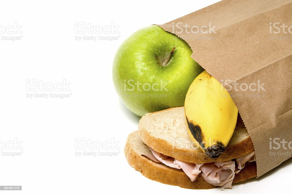 A healthy lunch spilling from a brown bag stock photo