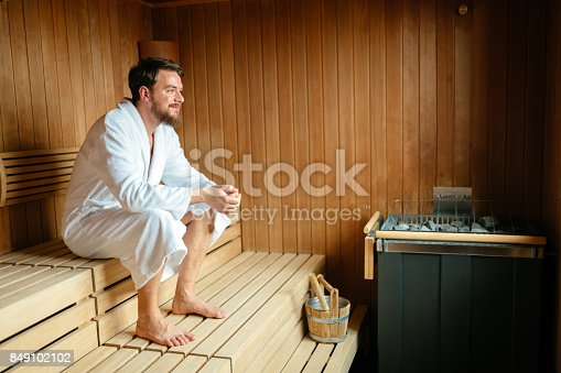 Healthy male in sauna relaxing and enjoying wellness weekend