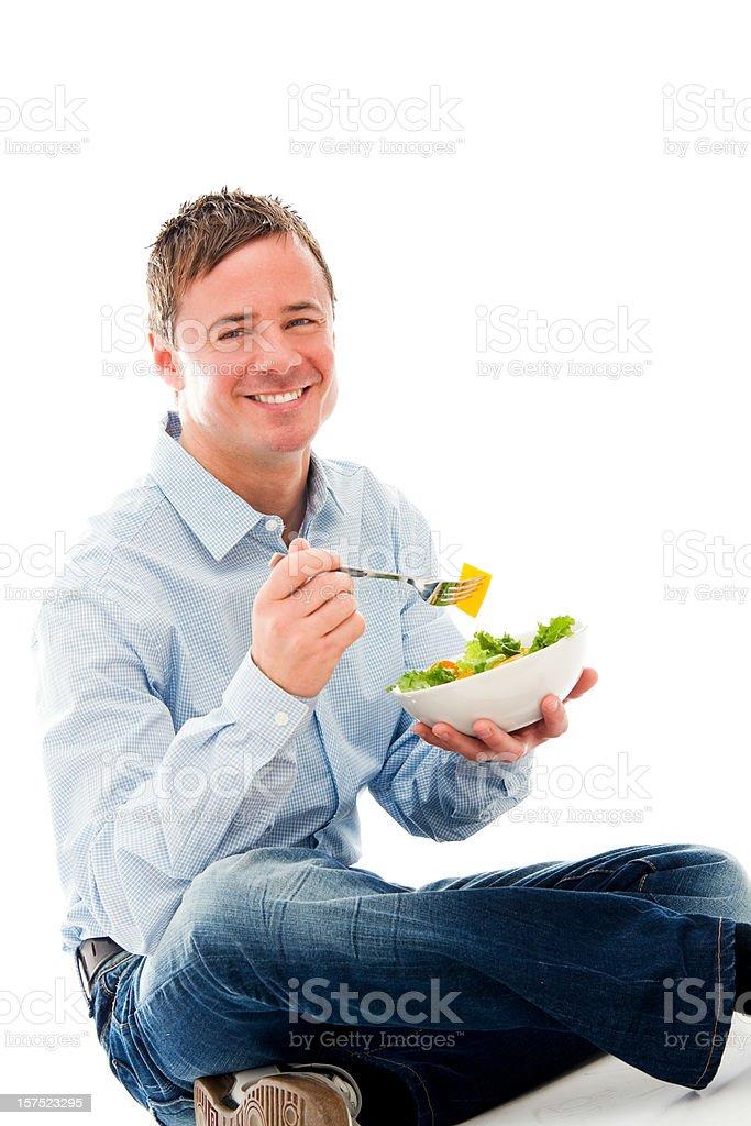 Healthy Man Eating a Salad royalty-free stock photo