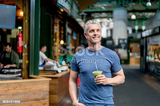 istock Healthy man having a smoothie 608491958
