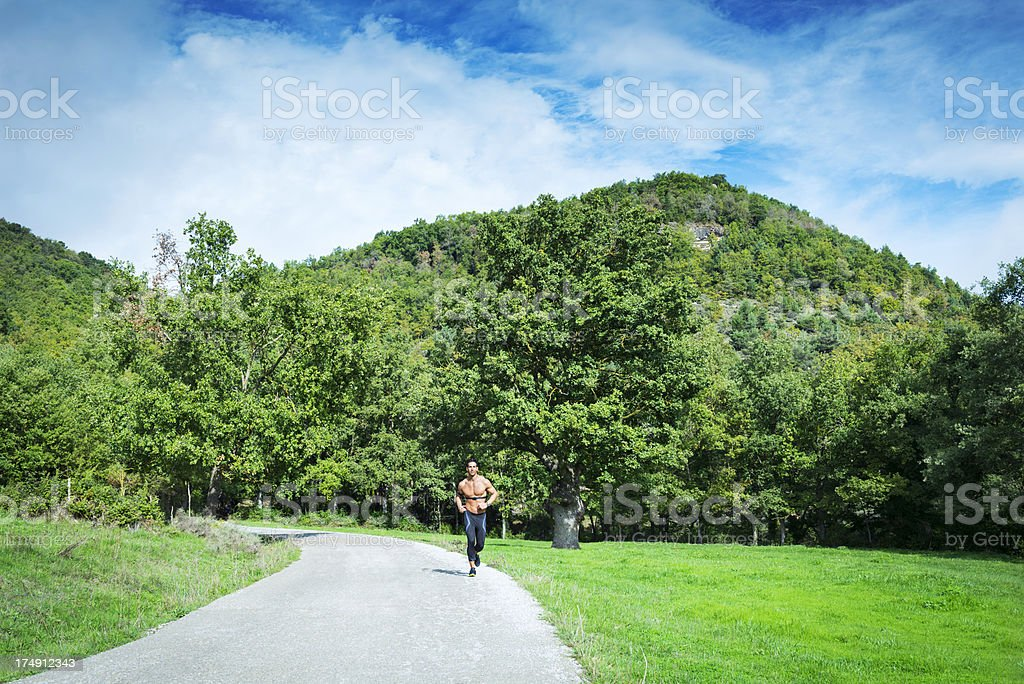 Healthy man jogging on a country road royalty-free stock photo