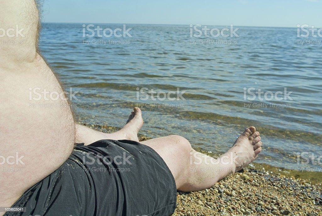 Healthy man on the beach. stock photo