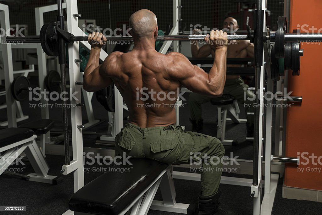 Healthy Mature Man Doing Exercise For Shoulder stock photo