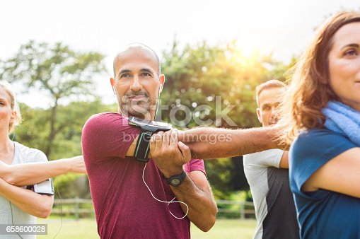 istock Healthy mature man stretching arm 658600028