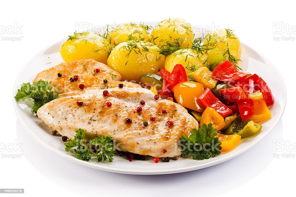 Healthy meal of chicken, potatoes and vegetables stock photo