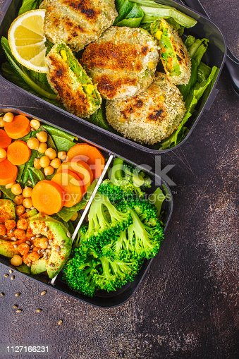 istock Healthy meal prep containers with green burgers, broccoli, chickpeas and salad. 1127166231