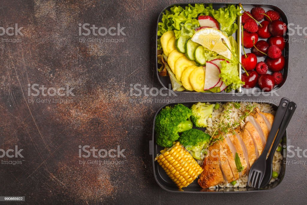 Healthy meal prep containers with grilled chicken with fruits, berries, rice and vegetables. Takeaway food, copy space royalty-free stock photo