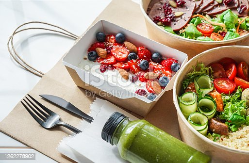 istock Healthy meal slimming diet plan daily ready menu background, organic fresh dishes and smoothie, fork knife on paper eco bag as food delivery courier service at home in office concept, close up view. 1262278902