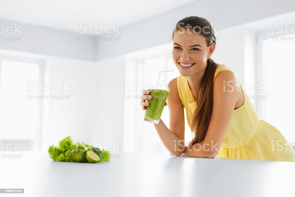 Healthy Meal. Happy Beautiful Smiling Woman Drinking Green Detox...