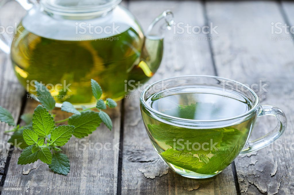 Healthy melissa tea natural organic aromatic drink in glass cup stock photo
