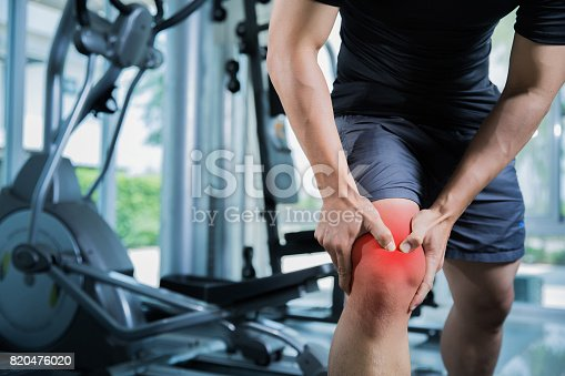 istock Healthy men Injury from exercise in the gym, he injured his knee 820476020