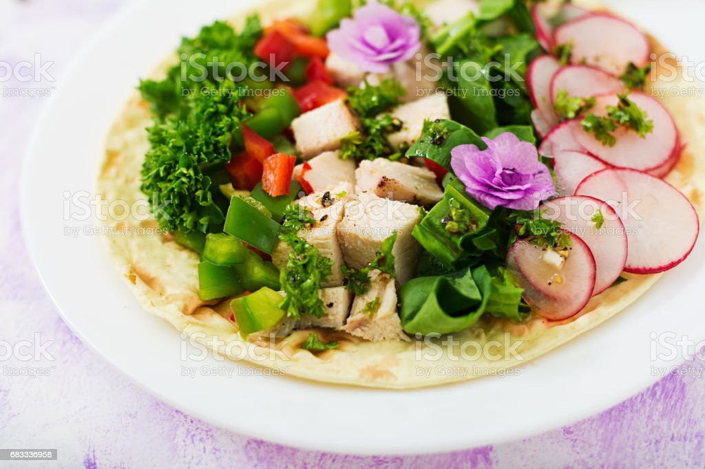 Healthy mexican corn tacos with boiled chicken breast, spinach, radish and paprika. royalty-free stock photo