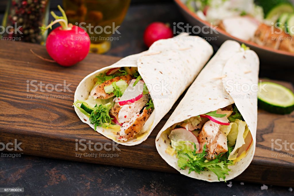Healthy mexican tacos with baked chicken breast, cucumber, radish and lettuce. - Royalty-free Appetizer Stock Photo