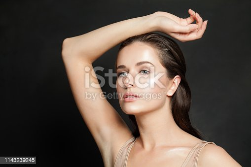 Healthy model with clear skin on black background