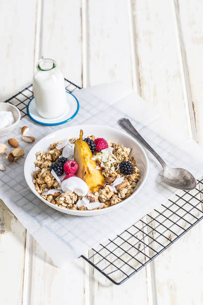 healthy muesli breakfast - anthony mcgovern stock photos and pictures