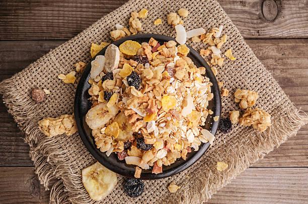 healthy muesli in bowl stock photo