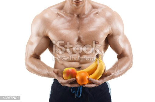 istock Healthy muscular man holding a fresh fruits, isolated on white 495672621
