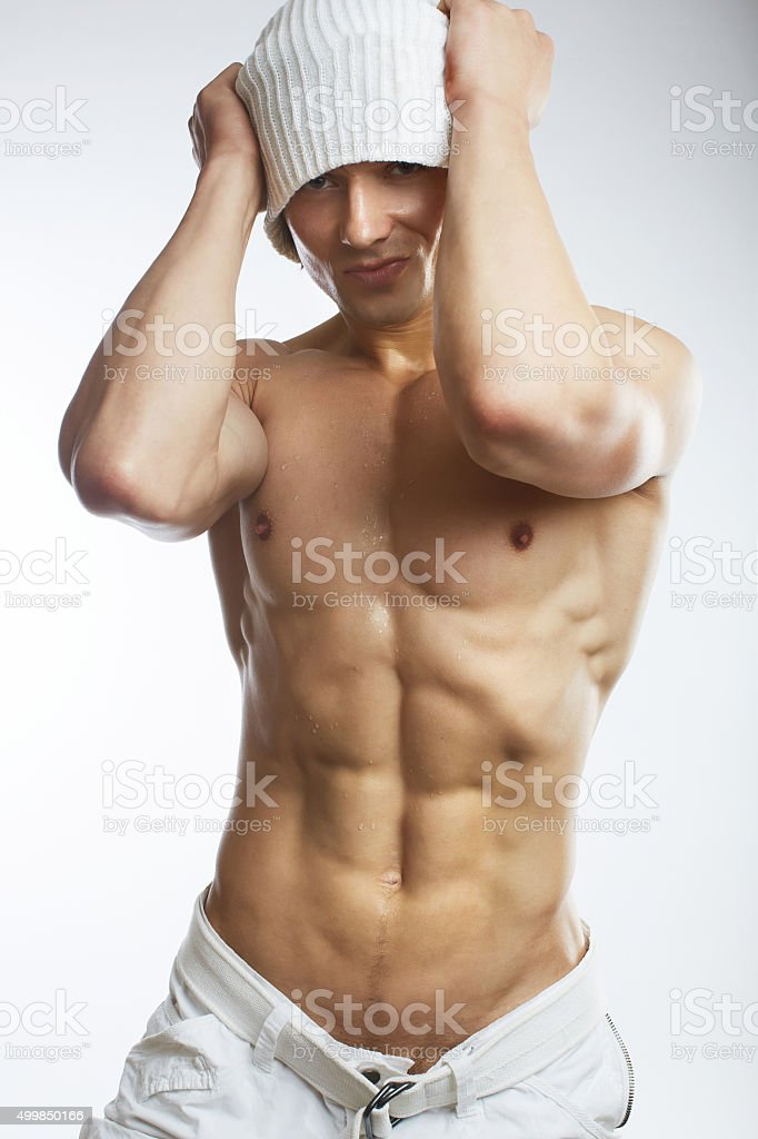 Healthy muscular young man stock photo