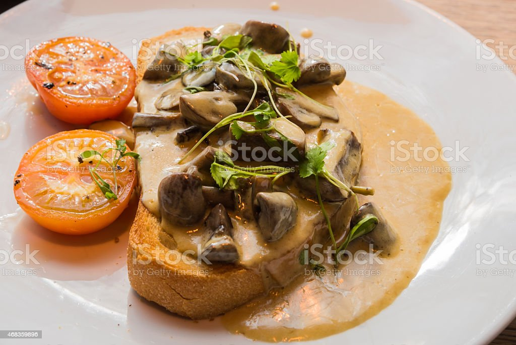 Healthy mushrooms toast sandwich with sliced tomato and parsley royalty-free stock photo