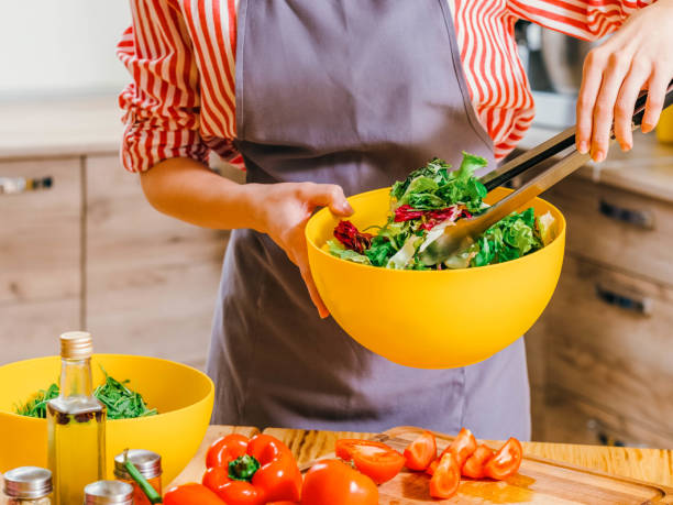 healthy nutrition woman cooking vegetable salad stock photo
