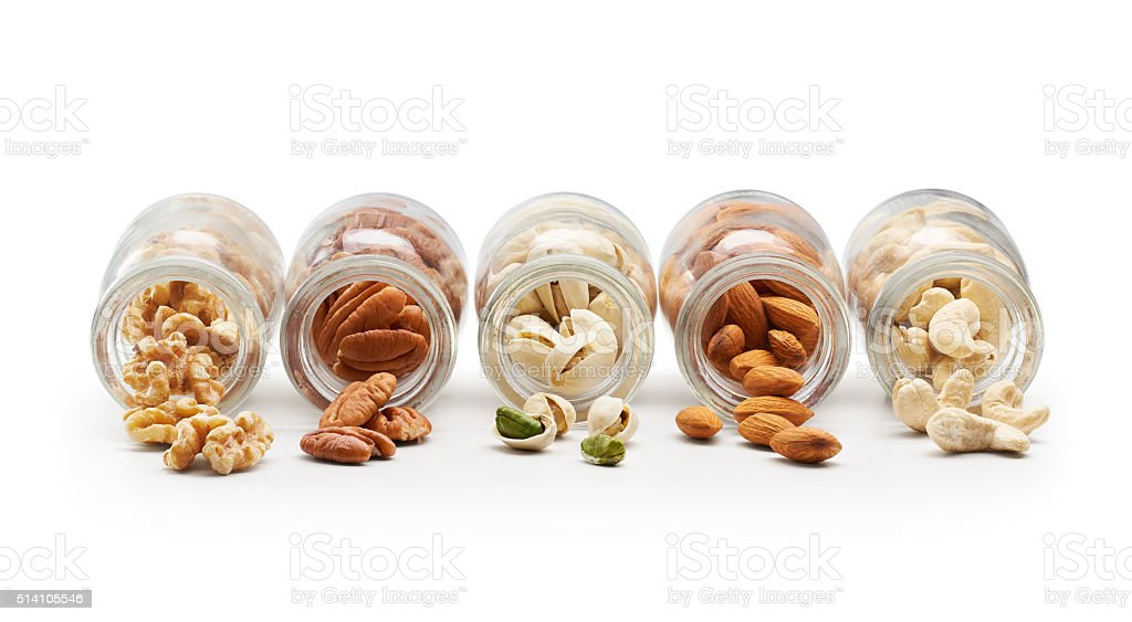 Healthy Nuts Pouring Out From Bottle stock photo