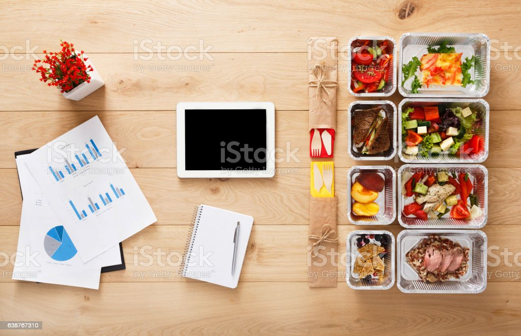 Healthy office lunch in boxes, top view at wood stock photo