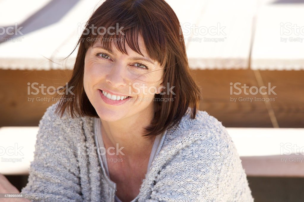 Healthy older woman smiling outside royalty-free stock photo