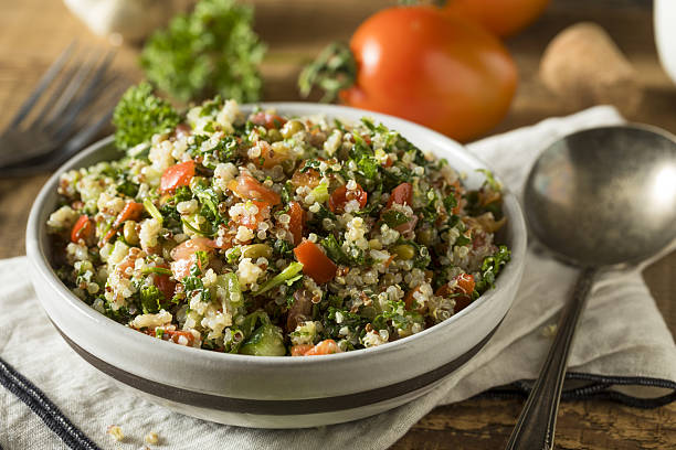 healthy organic quinoa tabouli salad - quinoa stock photos and pictures