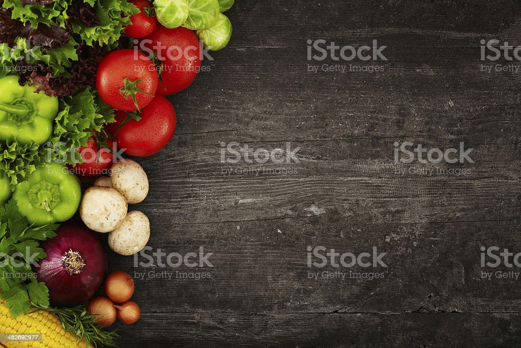 Healthy Organic Vegetables on a Wooden Background royalty-free stock photo