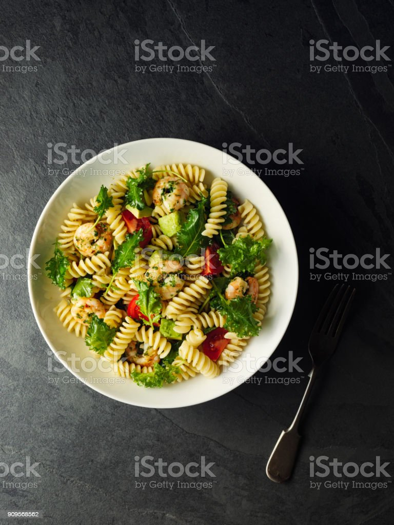 Healthy pasta salad with grilled king prawn stock photo