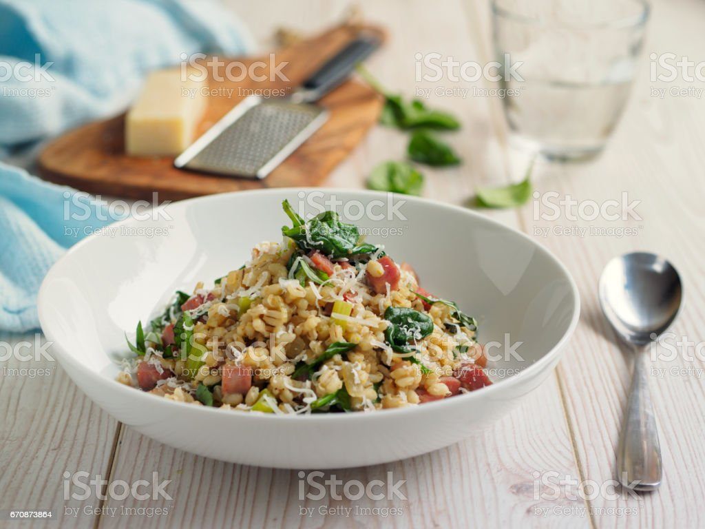 healthy pearl barley risotto stock photo