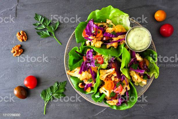Healthy Plant Based Lettuce Wraps With Grilled Cauliflower Top View Over A Dark Slate Background Stock Photo - Download Image Now
