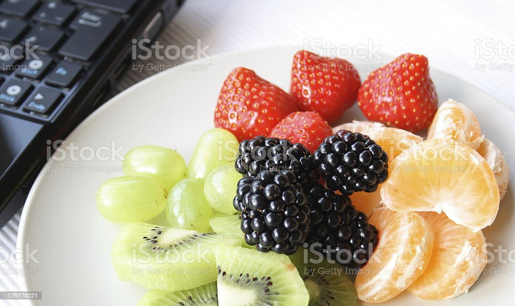 Healthy Plate of Fruit With Work royalty-free stock photo