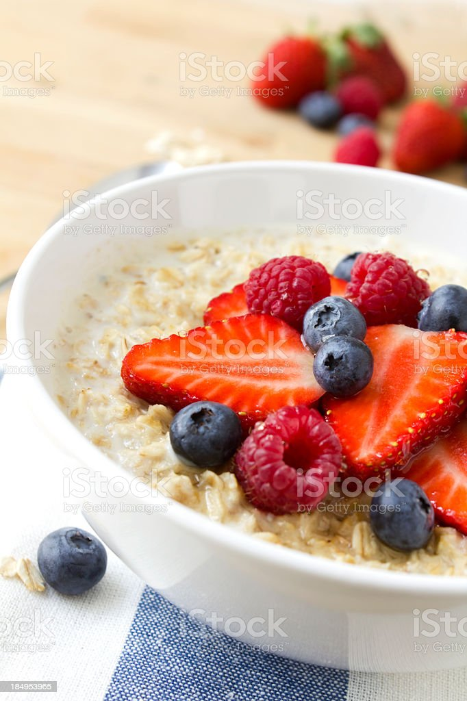 A healthy porridge with fresh berries stock photo