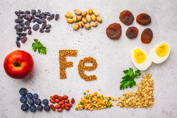 Healthy product sources of iron. Top view, food background, Fe ingredients on a white background. Healthy product sources of Fe. Top view, food background, iron ingredients: buckwheat, dried fruit, apple, eggs on a white background. anemia stock pictures, royalty-free photos & images