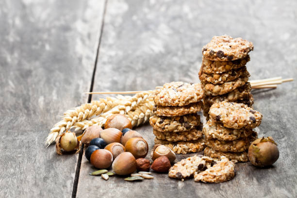 Healthy  protein granola crackers with seeds and nuts on wooden table Healthy  protein granola crackers with seeds and nuts on wooden table spelt stock pictures, royalty-free photos & images