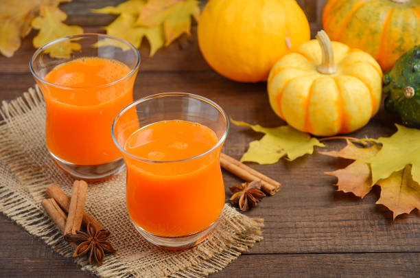 Healthy pumpkin juice in glasses on autumn background stock photo